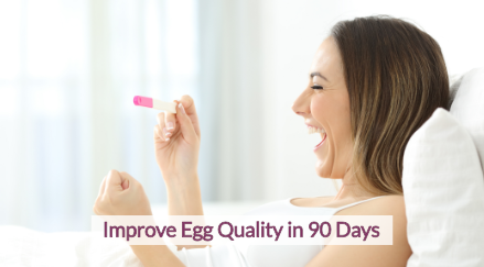 Women laying in bed cheering enthusiastically with a positive pregnancy test in her hand. Text on top of image that says 'Improve egg quality in 90 days""