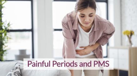 Woman bent over in pain from her painful periods